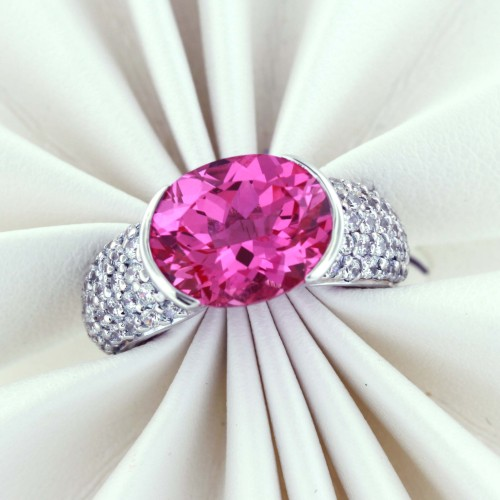 SS Center Stone Lab Created Pink Sapphire, Oval Shape  6.25 carats, Powder Pink Hue with Brilliant Sparkle. Side Stones 62 pieces White Cubic Zirconia. Ring $145